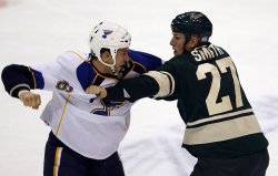 St. Louis Blues B.J. Crombeen and Minnesota Wild Nathan Smith