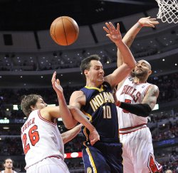 Bulls Korver and Boozer foul Pacers Foster in Chicago