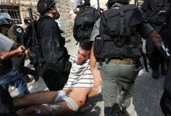 Israeli riot police arrest a Palestinian in Jerusalem