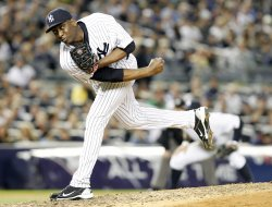 New York Yankees relief pitcher Rafael Soriano throws a pitch in Game 5 of the ALDS at Yankee Stadium in New York