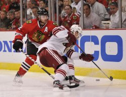 Blackhawks' Keith and Coyotes' Boedker go for puck in Chicago