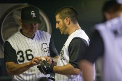 Rockies Marquis Talks to Pitching Coach Apodaca in Denver