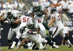 New York Jets Safety Kerry Rhodes and Cornerback Donald Strickland Bring Down Houston Texans Quarterback Matt Schaub at Reliant Stadium in Houston