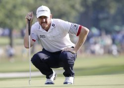 Jimmy Walker putts on the 17th hole at the PGA