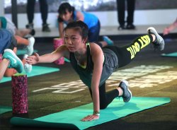 Chinese women participate in a Nike-sponsored fitness event in Beijing