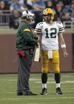 Green Bay Packers head coach Mike McCarthy talks with quarterback Aaron Rodgers in Detroit