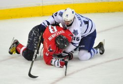 Capitals Alex Ovechkin and Maple Leafs Clarke MacArthur tie up in Washington