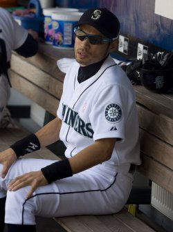Seattle Mariners' Ichiro Suzuki watches Jose Lopez at bat.