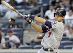 Minnesota Twins Joe Mauer hits a double at Yankee Stadium in New York