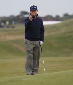 Tom watson takes a picture during his practice round