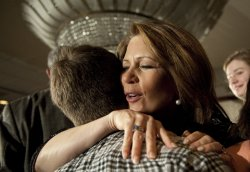 Bachmann hugs family and friends after concession in Des Moines, Iowa