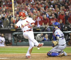 Cardinals Rafael Furcal is hit by Texas Rangers pitcher C.J. Wilson with bases loaded during game 7 of World Series in St. Louis