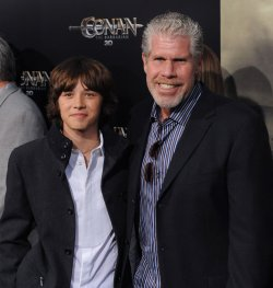 "Leo Howard and Ron Perlman attend the premiere of ""Conan the Barbarian"" in Los Angeles"