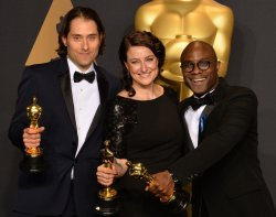 Jeremy Kleiner, Adele Romanski andBarry Jenkins appear backstage with their Oscars at the 89th annual Academy Awards in Hollywood
