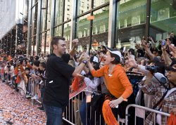 Giants pitcher Jeremy Affeldt thrills a fan during a massive parade in San Francisco