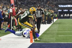 Green Bay Packers wide receiver Davante Adams is stopped short of the goal