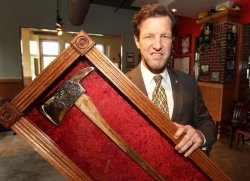 Rep. Russ Carnahan receives fire axe from St. Louis firefighters