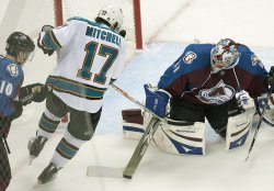 Avalanche Goalie Anderson Makes Stick Save Against Sharks Mitchell in Game Three in Denver