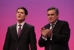Gordon Brown applauds his Foreign Secretary David Miliband after his policy speech.