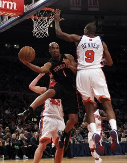 Toronto Raptors Jarrett Jack passes the ball under the basket against the New York Knicks at Madison Square Garden in New York