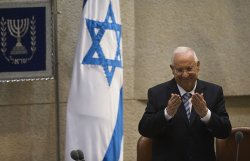 Newly sworn-in Israeli President Reuven Rivlin gestures during a ceremony in Jerusalem