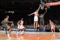 New York Knicks Josh Harrellson tries to block a shot from Milwaukee Bucks Brandon Jennings at Madison Square Garden in New York