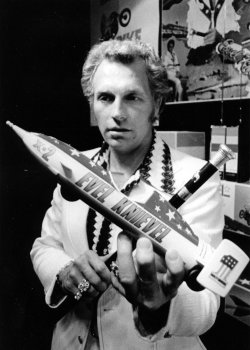Evel Knievel shows a model of the vehicle he will use in his attempted three-quarter-mile leap over a portion of Snake River Canyon.
