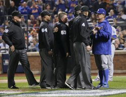 Umpires meet with managers before first pitch