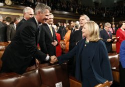 U.S. Senator Scott Brown greets Secretary of State Hillary Clinton before President Barack Obama addressed a joint session of the United States Congress in Washington