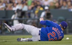 Cubs Pitcher Zorzelanny Dives for Ball Against Rockies in Denver