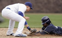 Cubs Second Baseman Baker Makes Tag on Brewers Weeks