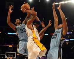 O.J. Mayo blocks shot of Los Angeles Lakers Kobe Bryant in Los Angeles