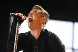 Robbie Williams performs in London