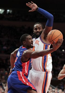 New York Knicks Ronny Turiaf looks to block the shot from Detroit Pistons Ben Gordon at Madison Square Garden in New York