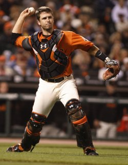 Giants Buster Posey throws out Padres Clayton Richard in San Francisco