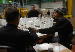 Palestinians Work In SodaStream Factory In West Bank