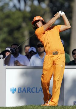 Rickie Fowler hits a tee shot at Ridgewood Country Club in New Jersey