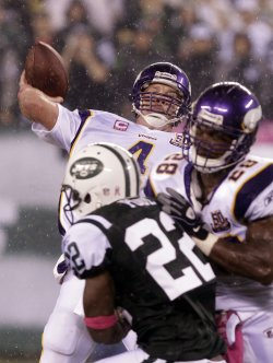 Minnesota Vikings quarterback Brett Favre throws his 500th career touchdown pass at New Meadowlands Stadium in New Jersey