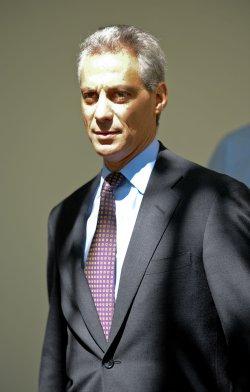 Rahm Emanuel listens to U.S. President Obama speak on West Virginia mine tragedy in Washington