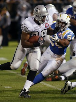 Raiders Michael Bush runs against the Chargers in Oakland