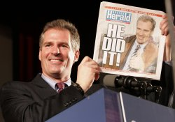 Scott Brown holds up paper to celebrate win in Massachusetts special election for U.S. Senate.