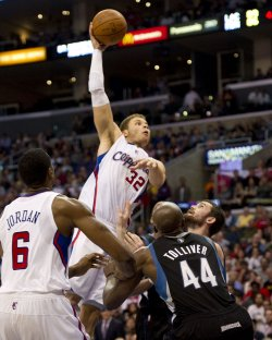 Los Angeles Clippers Blake Griffin shoots over Minnesota Timberwolves Kevin Love and Anthony Tolliver