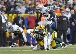 Packers Jennings tackled after catch against Raiders in Green Bay, Wisconsin