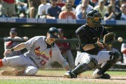 Cardinals Ryan Scores Against Rockies Torrealba in Denver