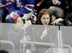 Debra Messing watches the New York Rangers