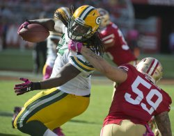 Packers Aaron Ripkowsk tackled by 49ers Lynch