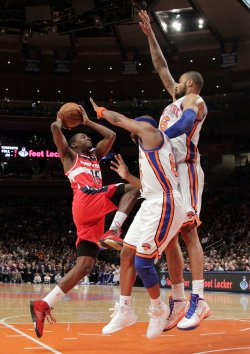 New York Knicks Tyson Chandler and Baron Davis try to block a shot from Washington Wizards Jordan Crawford at Madison Square Garden in New York