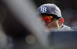 Tampa Bay Rays Matt Garza watches from the dug out at Yankees Stadium in New York