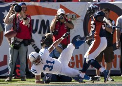 Broncos Williams Breaks Up Pass to Colts McBath in the Endzone in Denver