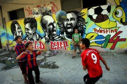Wall murals depict football players in World Cup